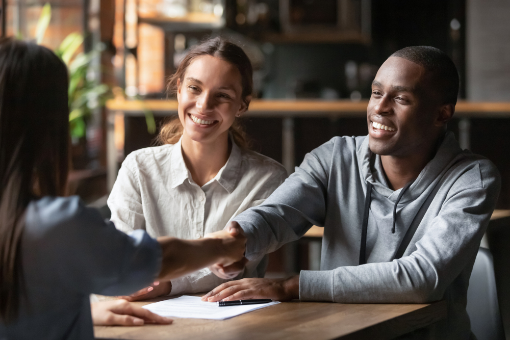 Happy,Young,Interracial,Couple,Shake,Hand,Of,Bank,Manager,Broker